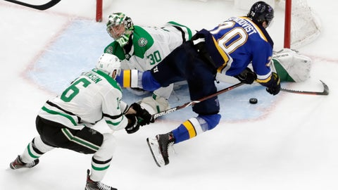 <p>               Dallas Stars goaltender Ben Bishop (30) blocks a shot by St. Louis Blues center Oskar Sundqvist (70), of Sweden, during the third period in Game 5 of an NHL second-round hockey playoff series Friday, May 3, 2019, in St. Louis. Also defending for the Stars is Jason Dickinson (16). The Stars won 2-1 and lead the series 3-2. (AP Photo/Jeff Roberson)             </p>
