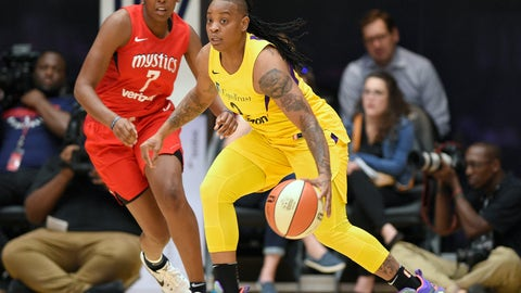 <p>               FILE - In this Thursday, Aug. 23, 201 file photo,L os Angeles Sparks guard Riquna Williams, right, dribbles against Washington Mystics guard Ariel Atkins (7) in the first half of a single elimination WNBA basketball playoff game in Washington. The Los Angeles Sparks re-signed free agent Riquna Williams, who was arrested last month after fight with her ex-girlfriend at a Florida home. According to an arrest report, Williams forced her way inside and repeatedly struck Alkeria Davis in the head and pulled her hair. Williams was booked April 29, 2019 for burglary and aggravated assault charges. She pleaded not guilty on May 6 and a hearing is set for June 6. (AP Photo/Nick Wass, File)             </p>