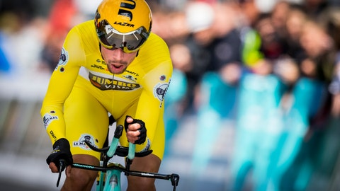 <p>               Winner Primoz Roglic from Slovenia of team Jumbo-Visma rides his bike during the fifth and last stage, a 16,85 km race against the clock at the 73th Tour de Romandie UCI ProTour cycling race in Geneva, Switzerland, Sunday, May 5, 2019. (Jean-Christophe Bott/Keystone via AP)             </p>