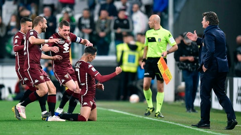 <p>               Torino's Sasa Lukic, center, celebrates after scoring the first goal of the game during the Italian Serie A soccer match between Juventus FC and Torino FC at the Allianz Stadium in Turin, Italy, Friday, May 3, 2019. (Alessandro Di Marco/ansa via AP)             </p>