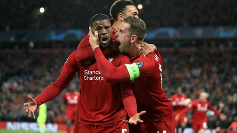 <p>               Liverpool's Georginio Wijnaldum, left, celebrates scoring his side's third goal of the game during the Champions League Semi Final, second leg soccer match between Liverpool and Barcelona at Anfield, Liverpool, England, Tuesday, May 7, 2019. (Peter Byrne/PA via AP)             </p>