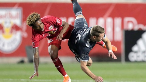 <p>               New York Red Bulls defender Kyle Duncan, left, and Vancouver Whitecaps midfielder Brett Levis collide while competing for the ball during the first half of an MLS soccer match Wednesday, May 22, 2019, in Harrison, N.J. (AP Photo/Julio Cortez)             </p>