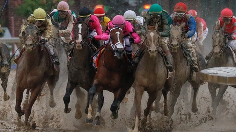<p>               Luis Saez riding Maximum Security, second from right, goes around turn four with Flavien Prat riding Country House, left, Tyler Gaffalione riding War of Will and John Velazquez riding Code of Honor, right, during the 145th running of the Kentucky Derby horse race at Churchill Downs Saturday, May 4, 2019, in Louisville, Ky. (AP Photo/John Minchillo)             </p>