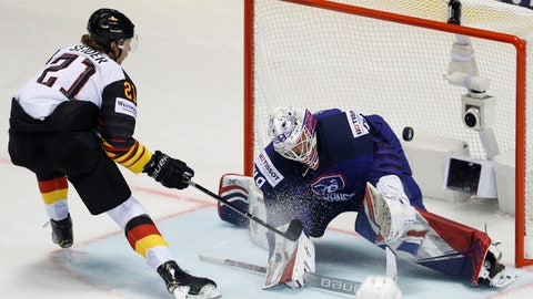 <p>               Germany's Moritz Seider, left, scores his sides first goal past goaltender Florian Hardy of France, right, during the Ice Hockey World Championships group A match between Germany and France at the Steel Arena in Kosice, Slovakia, Tuesday, May 14, 2019. (AP Photo/Petr David Josek)             </p>