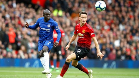 <p>               Chelsea's N'Golo Kante, left, and Manchester United's Ander Herrera battle for the ball during their English Premier League soccer match at Old Trafford, Manchester, England, Sunday, April 28, 2019. (Martin Rickett/PA via AP)             </p>