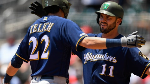 <p>               Milwaukee Brewers' Christian Yelich is congratulated at home plate by Mike Moustakas (11) after hitting a home run to center field during the first inning of a baseball game against the Atlanta Braves, Sunday, May 19, 2019, in Atlanta. (AP Photo/John Amis)             </p>