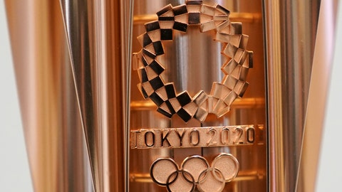 """<p>               FILE - This March 20, 2019, file photo shows the emblem of the Olympic torch of the Tokyo 2020 Olympic Games during a press conference in Tokyo. Tokyo organizers said Wednesday, May 8, 2019, they are trying to cut spending, under pressure from the International Olympic Committee, which has been widely criticized for driving Olympic cities to build """"white elephant"""" venues, often at the taxpayers expense. (AP Photo/Eugene Hoshiko, File)             </p>"""