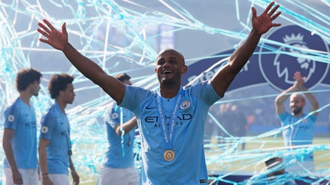 <p>               Manchester City's Vincent Kompany celebrates with his medal after the English Premier League soccer match between Brighton and Manchester City at the AMEX Stadium in Brighton, England, Sunday, May 12, 2019. Manchester City defeated Brighton 4-1 to win the championship. (AP Photo/Frank Augstein)             </p>