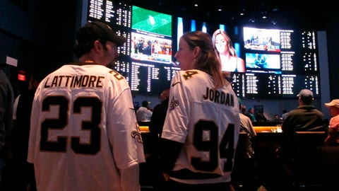 <p>               In this Sept. 9, 2018 photo, football fans wait for kickoff in the sports betting lounge at the Ocean Casino Resort in Atlantic City, N.J. Since sports betting became legal last year in New Jersey, the state's casinos and racetracks had taken more than $2.6 billion worth of bets through the end of April 2019. (AP Photo/Wayne Parry)             </p>
