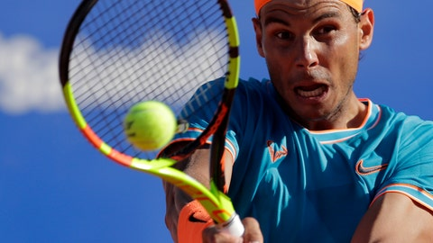 <p>               Spain's Rafael Nadal returns the ball to Austria's Dominic Thiem during their semifinal match at the Barcelona Open Tennis Tournament in Barcelona, Spain, Saturday, April 27, 2019. (AP Photo/Manu Fernandez)             </p>