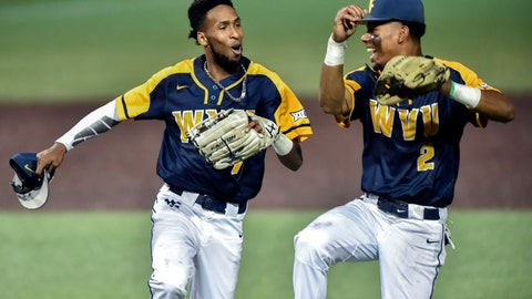 <p>               West Virginia's Brandon White (7) and Tevin Tucker (2) celebrate after closing out an inning against Fordham during an NCAA college baseball regional tournament  Friday, May 31, 2019, in Morgantown, W.V. (William Wotring/The Dominion-Post via AP)             </p>