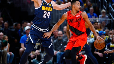 <p>               Portland Trail Blazers guard CJ McCollum, right, drives past Denver Nuggets forward Mason Plumlee in the first half of Game 7 of an NBA basketball second-round playoff series Sunday, May 12, 2019, in Denver. (AP Photo/John Leyba)             </p>