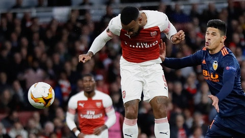 <p>               Arsenal's Alexandre Lacazette heads the ball to score his side's second goal, during the Europa League semifinal first leg soccer match between Arsenal and Valencia at the Emirates stadium in London, Thursday, May 2, 2019. (AP Photo/Kirsty Wigglesworth)             </p>