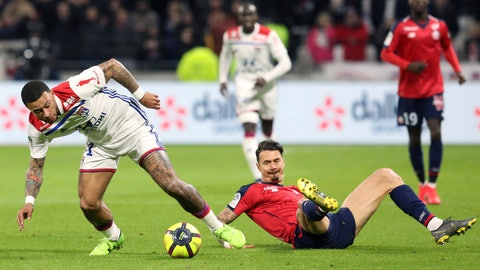 <p>               Lyon's Memphis Depay, left, challenges for the ball with Lille's Jose Miguel Da Rocha Fonte, right, during a French League One soccer match in Decines, near Lyon, central France, Sunday, May 5, 2019. (AP Photo/Laurent Cipriani)             </p>