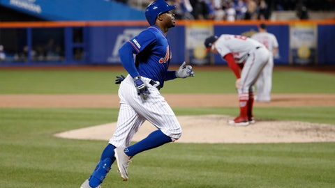 <p>               New York Mets' Rajai Davis, left, runs between third and home on his eighth-inning, three-run home run in the team's baseball game against the Washington Nationals, Wednesday, May 22, 2019, in New York, as Nationals relief pitcher Sean Doolittle, right, reacts on the mound. (AP Photo/Kathy Willens)             </p>