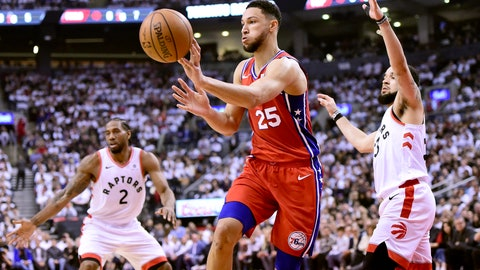 <p>               Philadelphia 76ers guard Ben Simmons (25) passes the ball as Toronto Raptors forward Kawhi Leonard (2) and teammate Fred VanVleet (23) look on during first half NBA Eastern Conference semifinal action in Toronto on Sunday, May 12, 2019. (Frank Gunn/The Canadian Press via AP)             </p>