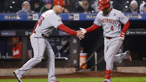 <p>               Cincinnati Reds' Jose Iglesias, right, celebrates with third base coach J.R. House after hitting a home run during the ninth inning of the team's baseball game against the New York Mets on Wednesday, May 1, 2019, in New York. The Reds won 1-0. (AP Photo/Frank Franklin II)             </p>