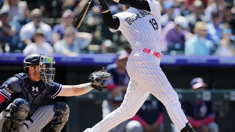 <p>               Colorado Rockies' Charlie Blackmon (19) hits a home run in the fourth inning of a baseball game as San Diego Padres catcher Austin Allen, left, looks on in Denver, Sunday, May 12, 2019. (AP Photo/Joe Mahoney)             </p>