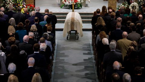 """<p>               The casket NHL legend Leonard Patrick """"Red"""" Kelly lays at the Holy Rosary Roman Catholic Church during a funeral Mass in Toronto, Friday, May 10, 2019.  Kelly, a defenseman-turned-center whose Hall of Fame career included eight Stanley Cups while playing for Detroit and Toronto, died Thursday, May 1, 2019. He was 91. (Cole Burston/The Canadian Press via AP)             </p>"""