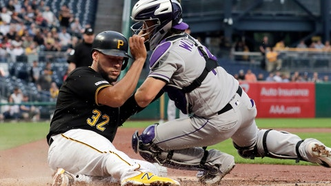 <p>               Pittsburgh Pirates' Elias Diaz (32) scores ahead of the tag attempted by Colorado Rockies catcher Tony Wolters during the second inning of a baseball game in Pittsburgh, Wednesday, May 22, 2019. (AP Photo/Gene J. Puskar)             </p>