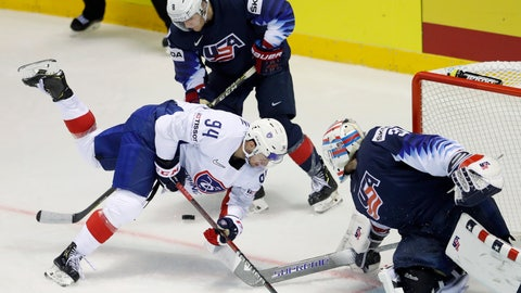 <p>               Thatcher Demko of the US, right, and Adam Fox of the US, back, challenge Tim Bozon of France, left, during the Ice Hockey World Championships group A match between the United States and France at the Steel Arena in Kosice, Slovakia, Sunday, May 12, 2019. (AP Photo/Petr David Josek)             </p>