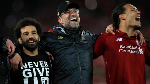 <p>               Liverpool's Mohamed Salah, left, manager Jurgen Klopp, center, and Virgil van Dijk celebrate after the Champions League Semi Final, second leg soccer match between Liverpool and Barcelona at Anfield, Liverpool, England, Tuesday, May 7, 2019. Liverpool won the match 4-0 to overturn a three-goal deficit to win the match 4-3 on aggregate. (Peter Byrne/PA via AP)             </p>