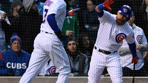 <p>               Chicago Cubs' Kris Bryant left, celebrates with teammate Willson Contreras after scoring on a Javier Baez sacrifice fly during the first inning of a baseball game against the Miami Marlins, Tuesday, May 7, 2019, in Chicago. (AP Photo/Paul Beaty)             </p>