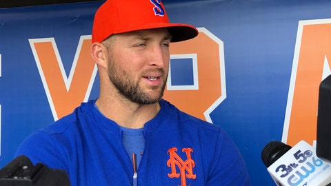 <p>               Syracuse Mets' Tim Tebow speaks with reporters prior to a minor league baseball game, Thursday, May 16, 2019 in Syracuse, N.Y. The former Heisman Trophy-winner and NFL quarterback is struggling with the Syracuse Mets but has begun to come alive at the plate with hits in five of the last six games. (AP Photo/John Kekis)             </p>