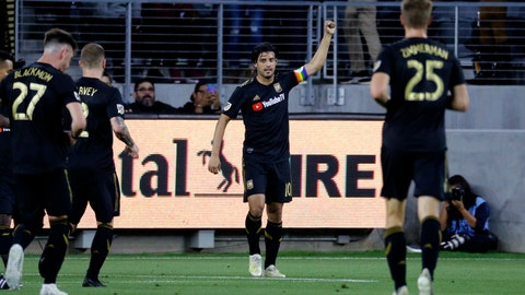 <p>               Los Angeles FC forward Carlos Vela (10) celebrates his goal against the Montreal Impact during the first half of an MLS soccer match in Los Angeles, Friday, May 24, 2019. (AP Photo/Ringo H.W. Chiu)             </p>