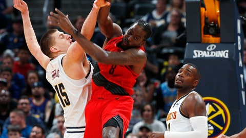 <p>               Denver Nuggets center Nikola Jokic, left, fights for control of a rebound with Portland Trail Blazers forward Al-Farouq Aminu during the first half of Game 2 of an NBA basketball second-round playoff series Wednesday, May 1, 2019, in Denver. (AP Photo/David Zalubowski)             </p>