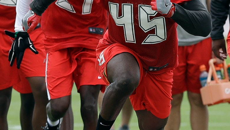 Bucs' 1st-round pick changes numbers, hits practice field