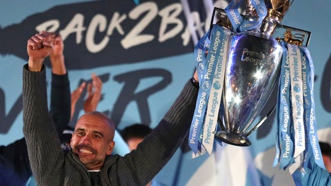 <p>               Manchester City coach Pep Guardiola holds the trophy as he celebrates with supporters at the Etihad Stadium in Manchester, England, Sunday May 12, 2019 the day they won the English Premier League title. Manchester City retained the Premier League trophy after coming from behind to beat Brighton 4-1 and see off Liverpool's relentless challenge on the final day of the season on Sunday. (AP Photo/Jon Super)             </p>