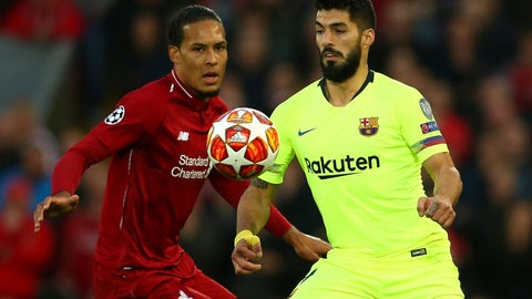 <p>               Liverpool's Virgil Van Dijk fights for the ball against Barcelona's Luis Suarez during the Champions League semifinal, second leg, soccer match between Liverpool and FC Barcelona at the Anfield stadium in Liverpool, England, Tuesday, May 7, 2019. (AP Photo/Dave Thompson)             </p>