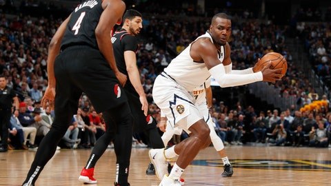 <p>               Denver Nuggets forward Paul Millsap, right, looks to shoot the ball as Portland Trail Blazers forward Maurice Harkless defends in the first half of Game 5 of an NBA basketball second-round playoff series, Tuesday, May 7, 2019, in Denver. (AP Photo/David Zalubowski)             </p>