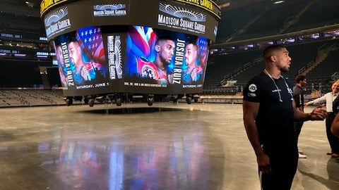 <p>               British boxer Anthony Joshua speaks to reporters at Madison Square Garden in New York, Monday, May 6, 2019. Joshua is scheduled to fight Andy Ruiz on Saturday for Joshua's WBA, WBO and IBF heavyweight titles. (AP Photo/Barry Wilner)             </p>