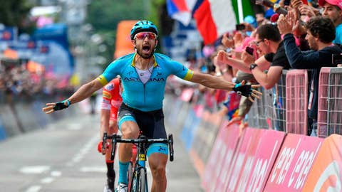 <p>               Italy's Dario Cataldo celebrates as he crosses the the finish line to win the 15th stage of the Giro d'Italia cycling race, from Ivrea to Como, Sunday, May 26, 2019. (Alessandro Di Meo/ANSA via AP)             </p>