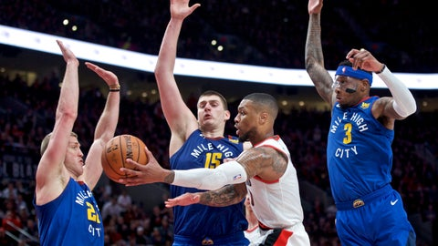 <p>               Portland Trail Blazers guard Damian Lillard, center, passes the ball away from Denver Nuggets forward Mason Plumlee, left, center Nikola Jokic, second from left, and forward Torrey Craig, right, during overtime of Game 3 of an NBA basketball second-round playoff series Friday, May 3, 2019, in Portland, Ore. (AP Photo/Craig Mitchelldyer)             </p>