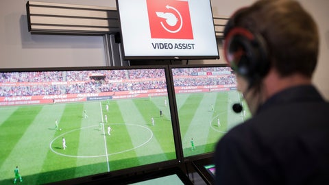 <p>               File - In this July 20, 2017 file photo, referee Sascha Stegemann sits in front of screens showing match sequences in a video assistant referee center in Cologne, Germany. Players, coaches and former referees have united in their criticism of the Bundesliga's video assistant referee after another weekend of questionable decisions in Germany's top soccer league. (Rolf Vennenbernd/dpa via AP)             </p>