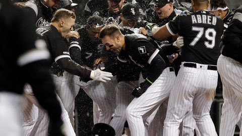 <p>               Chicago White Sox's Nicky Delmonico, center, is congratulated by teammates after hitting the game-winning three-run home run during the ninth inning of the team's baseball game against the Boston Red Sox in Chicago, Thursday, May 2, 2019. The White Sox won 6-4. (AP Photo/Nam Y. Huh)             </p>