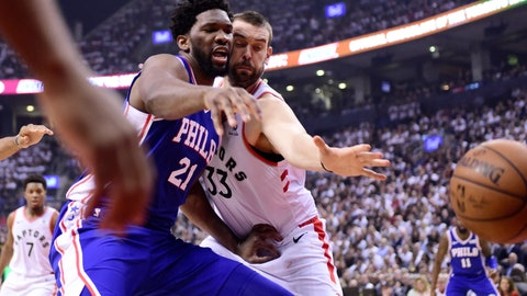<p>               Philadelphia 76ers center Joel Embiid (21) and Toronto Raptors center Marc Gasol (33) watch the ball get away during the first half of Game 5 of an NBA basketball second-round playoff series, Tuesday, May 7, 2019, in Toronto. (Frank Gunn/The Canadian Press via AP)             </p>
