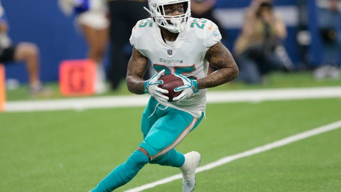 <p>               FILE - In this Nov. 25, 2018, file photo, Miami Dolphins cornerback Xavien Howard runs back an interception against the Indianapolis Colts during the first half of an NFL football game in Indianapolis. Howard has agreed to terms on a $76.5 million, five-year extension with the Dolphins, the most lucrative deal ever for an NFL cornerback. The contract includes $46 million guaranteed, and ensures Howard will be a cornerstone in the team's rebuilding effort under new coach Brian Flores. (AP Photo/AJ Mast, File)             </p>