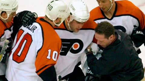 <p>               FILE - In this May 26, 2000, file photo, Philadelphia Flyers Eric Lindros, third from right, is assisted after getting hit in the first period of Game 7 of their NHL hockey Eastern Conference finals against the New Jersey Devils in Philadelphia. Lindros could easily be the poster boy for concussions in the NHL given his experience.  (AP Photo/Chris Gardner, File)             </p>