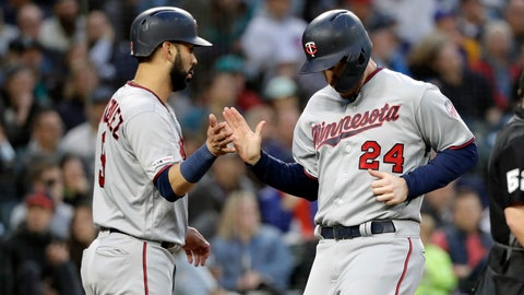 <p>               Minnesota Twins' Marwin Gonzalez greets C.J. Cron (24) after the two scored against the Seattle Mariners during the fifth inning of a baseball game Friday, May 17, 2019, in Seattle. (AP Photo/Elaine Thompson)             </p>