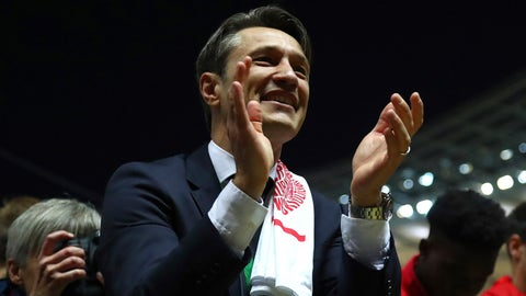 <p>               Bayern coach Niko Kovac celebrates with his players with the trophy after winning the German soccer cup, DFB Pokal, final match between RB Leipzig and Bayern Munich at the Olympic stadium in Berlin, Germany, Saturday, May 25, 2019. (AP Photo/Matthias Schrader)             </p>