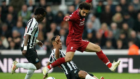 <p>               Liverpool's Mohamed Salah jumos over a challenge from Newcastle United's Isaac Hayden during the English Premier League soccer match at St James' Park, Newcastle, England, Saturday May 4, 2019. (Owen Humphreys/PA via AP)             </p>