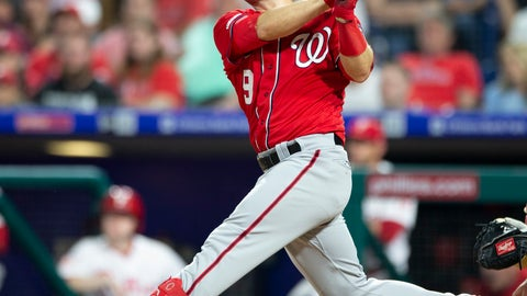 <p>               Washington Nationals' Brian Dozier (9) follows through on a home run in the second inning of a baseball game against the Philadelphia Phillies, Saturday, May 4, 2019, in Philadelphia. (AP Photo/Laurence Kesterson)             </p>
