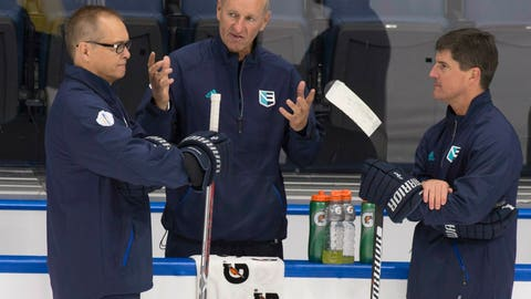 <p>               FILE - In this Sept. 5, 2016, file photo ,Team Europe head coach Ralph Krueger, center, chats with assistant coaches Paul Maurice, left, and Brad Shaw during practice in preparation for the World Cup of Hockey tournament at the Videotron Centre in Quebec City. Coaches who have worked closely with Krueger over the years are glad he's back as a part of their fraternity after five years as chairman of English Premier League soccer club Southampton FC. The Buffalo Sabres recently hired Krueger as their new coach. (Jacques Boissinot/The Canadian Press via AP, File)             </p>