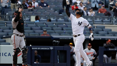 <p>               New York Yankees' Gleyber Torres, right, gestures as he runs past Baltimore Orioles catcher Austin Wynns, left, after hitting a home run during the fourth inning of a baseball game Wednesday, May 15, 2019, in New York. (AP Photo/Frank Franklin II)             </p>