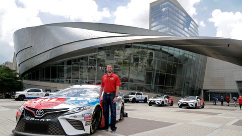 <p>               Driver Kyle Busch poses with his car for the Coca-Cola 600 NASCAR Cup series auto race during a news conference in Charlotte, N.C., Wednesday, May 8, 2019. The car will carry the name of fallen Army Sgt. Dale Griffin during the race on May 26, 2019. (AP Photo/Chuck Burton)             </p>