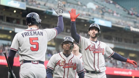 May 22, 2019; San Francisco, CA, USA; Atlanta Braves shortstop Dansby Swanson (7) celebrates with first baseman Freddie Freeman (5) after hitting a three RBI home run against the San Francisco Giants during the second inning at Oracle Park. Mandatory Credit: Stan Szeto-USA TODAY Sports